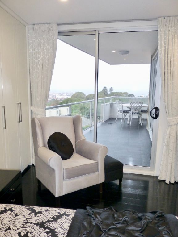 Master Bedroom with Silver Feature Chair