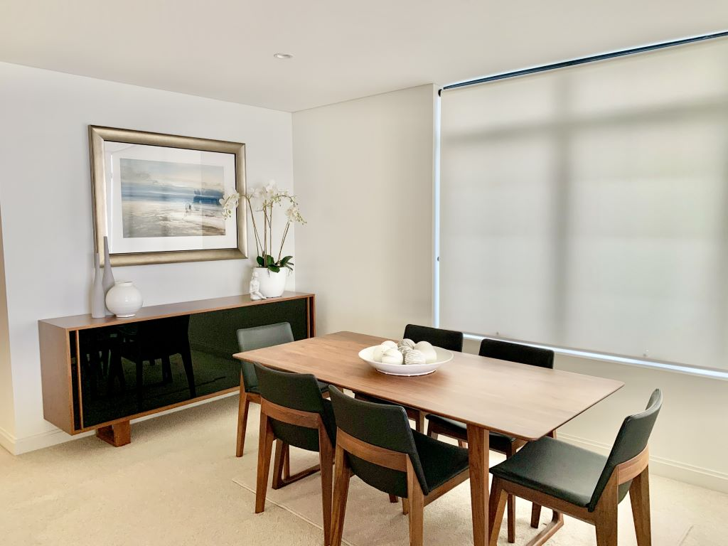 Contemporary Dining space with Walnut Timber Furniture