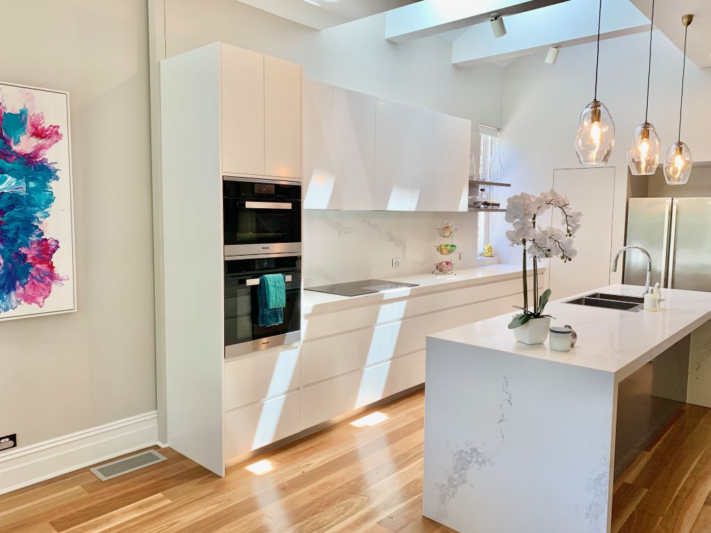 Contemporary Kitchen with 3 Handblown Glass Pendant Lights