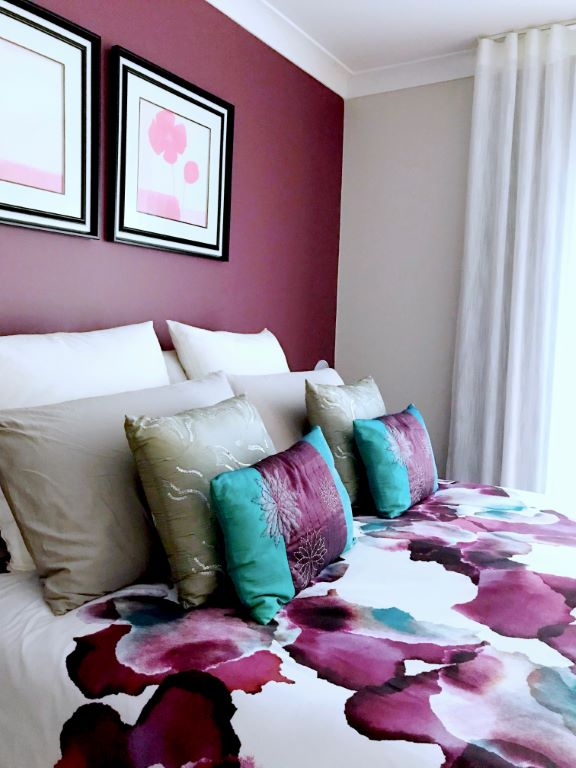 Contemporary Master Bedroom Vignette with a Dressed Bed