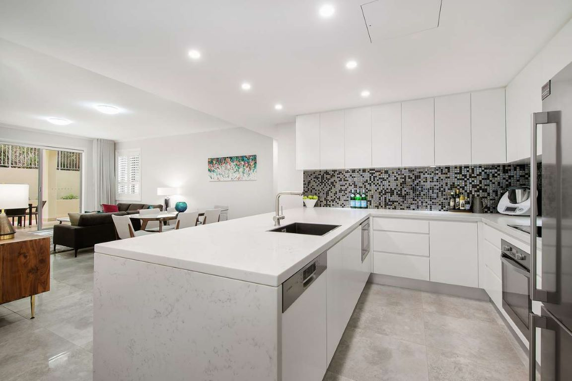 Contemporary White and Grey Kitchen with Spanish Glass Tile Splashback