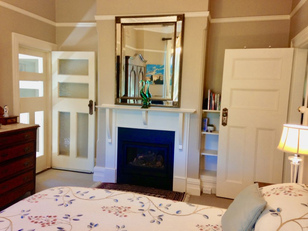 Country Style Master Bedroom with Fireplace