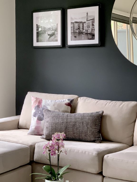 Dark Grey Feature Wall with Round Mirror and Artwork