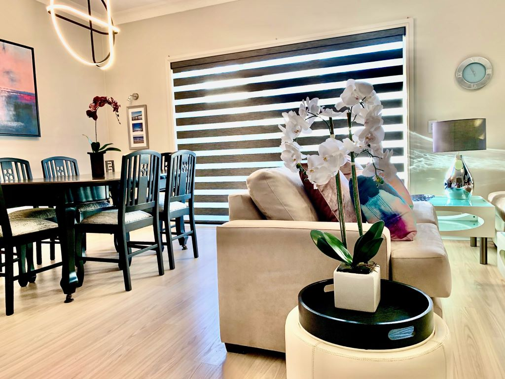 Lounge/Dining space with Black & White Furniture