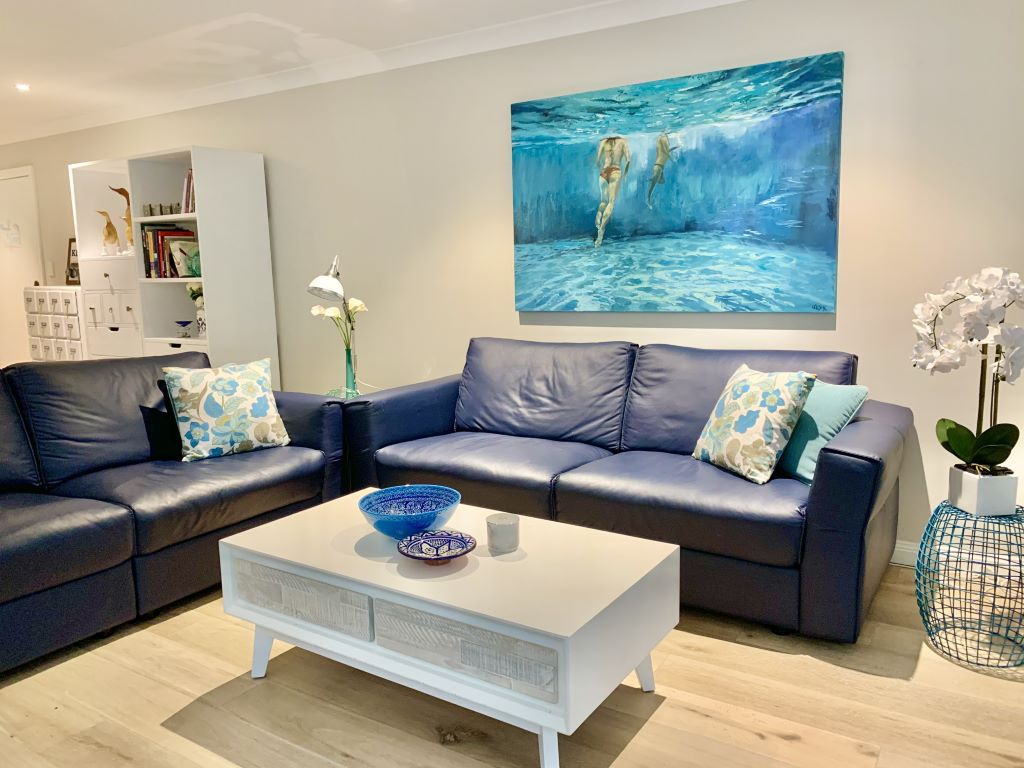 Modern Coastal Living Space with Navy Leather Sofas