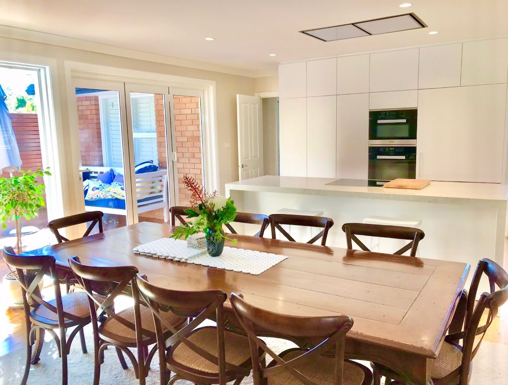 Modern Dining Space with French style Table and Crossback Chairs