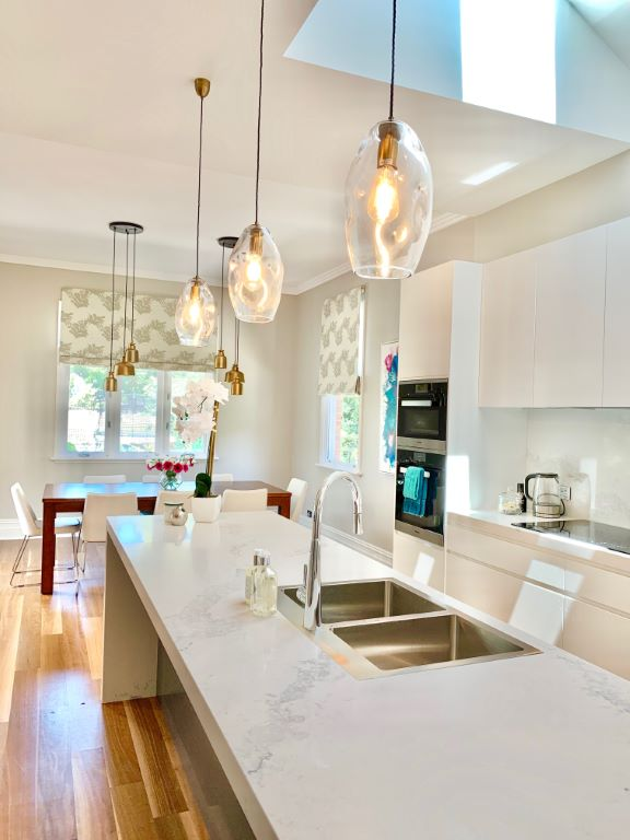 Modern Kitchen/Dining Space with Roman Blinds