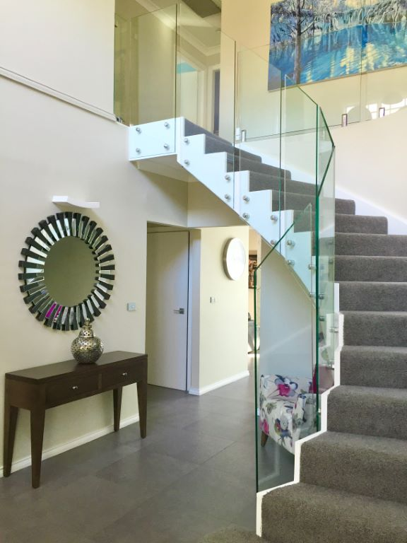 Transitional Front Entry with Curved Staircase
