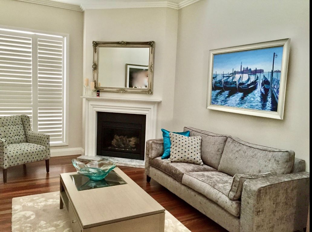 Transitional Living Space with Pops of Blue-Greens