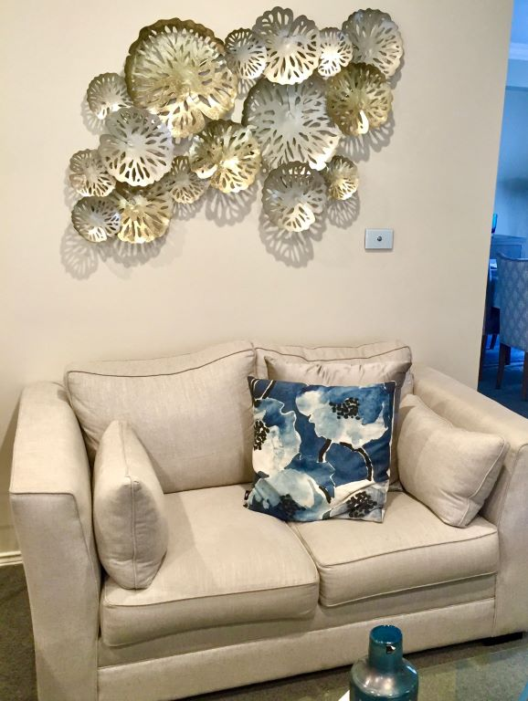 Transitional Sofa with Metal Wall Sculpture